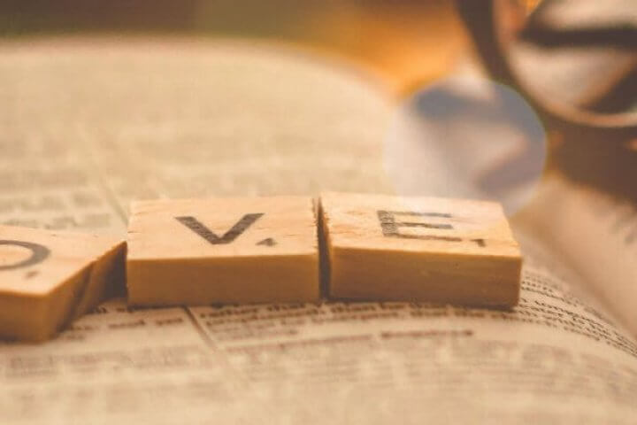 LOVE Scrabble pieces on Bible