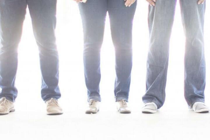 Men and Women Standing in front of light
